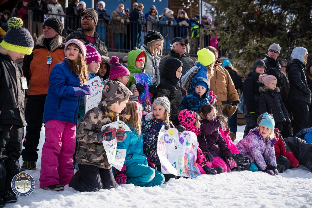 School Students watching the start of the Idaho Sled Dog Challenge